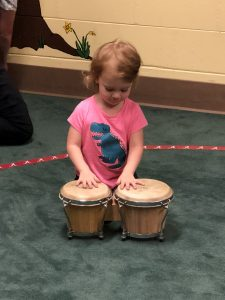 a small child playing drums
